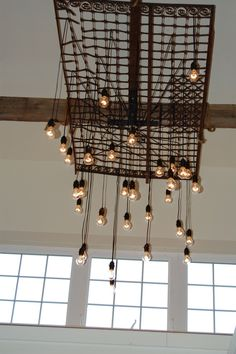 Image result for grid to hang from ceiling for retail lamp store