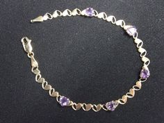 $95.00  10K Gold Amethyst Heart Cut Out link Tennis Bracelet 7 inch Lobster Claw w/ Box #Tennis ..... We are TOP RATED * POWER Sellers on EBAY * Selling WORLDWIDE. Visit us at our EBAY STORE * 4COOLSTUFF2BUY with any questions or items for sale. C100