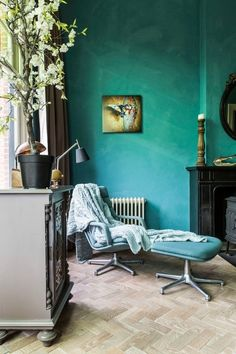 Marrs Green walls and butterfly art with an eclectic mix of vintage and contemporary furniture.