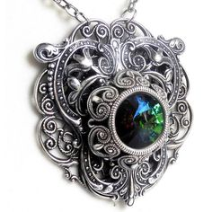 Gothic Necklace Swarovski Rivoli Sphinx Green Antique Silver Heart of... ($59) ❤ liked on Polyvore featuring jewelry, necklaces, heart necklaces, goth jewelry, heart jewelry, steel necklace and heart jewellery
