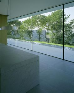 The cube of the main house was completely glazed with frameless windows.