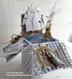 Handmade card in a box by DT member Anja with among others Creatables Tiny's Tall Ship (LR0416), Porthole (LR0417), Craftables Tiny's Ocean Set (CR1279) and Punch Die - Fish (CR1363) from Marianne Design