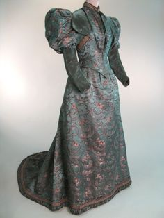 Peter Robinson Ltd, Europe, 1895-96.  Two piece dress with alternative bodice. Slate blue/orange shot silk velvet, slate blue silk satin brocaded with dark brown and cream sprays of flowers over small checked pattern of weft threads, pink chiffon.