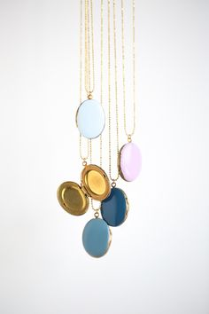 For the Makers: DIY Enameled Lockets Just paint a heavy coat of nail polish on the front!