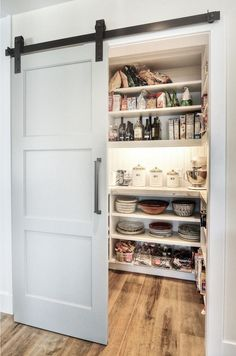 Modern pantry design with an elegant sliding barn door [Design: Dwellings Design. Modern pantry design with an elegant sliding barn door [Design: Dwellings Design… Modern pantry design with an elegant sliding barn door [Design: Dwellings Design Group] Kitchen Pantry Doors, New Kitchen, Kitchen Cabinets, Pantry Closet, Kitchen Ideas, Kitchen Decor, Pantry Room, Closet Doors, Barn Door Pantry