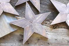 DIY Wood Stars - cut each start point piece separately with scroll saw, finish/paint/sand, glue & staple together; drill hole for string or hook