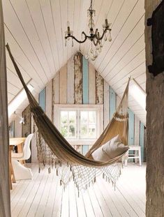 Relaxing hammock in a lovely lit attic.