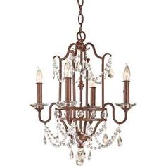 The Mocha Bronze Gianna Scuro chandelier. A glamorous traditional chandelier with four candelabra lights and sparkling crystal accents.