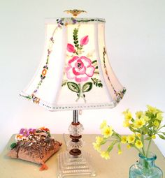 Pink Floral Lamp Shade Lampshade in Vintage Embroidery 5x10x7.5 high Hex Bell - Bedroom, Girls Room, Baby Shower Gift This handmade vintage embroidery lamp shade is made with a recent flea market find! New finds are always inspirational to design with!!! Shop shop is full to the brim with fabric but always need more! This shade has very pleasing colors, cheerful and pretty pinks and greens with lots of embroidery. Ive even used the embroidery for the trim.  This shade measures 5 corner to…