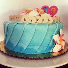 A tropical yet whimsical birthday cake