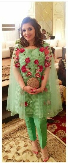 A Farah Talib Aziz creation. Soft green with flower embroidery. Love the cut and cape style of this dress.