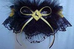 Hit the Road. This 'Dear' crossing garter is perfect for the trucker and his gal. Black lace with the authentic Deer-Xing road sign in yellow. #WesternWeddingGarter #CountryWeddingGarter #RusticWeddingGarter - Visit: www.garters.com/page62i.htm