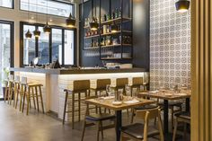 We created a bright and open environment with the use of abundant natural wood, light colors and patterns that represent Italian traditions. Key features of the space are the open kitchen, where fr…