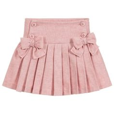 A pretty pink skirt for girls by Balloon Chic, made in soft flannel. It has button fastening on the dropped waist with adjustable elastic inside for a comfortable fit. The skirt is gathered on the back and pleated on the front with two sweet bows. Little Girl Skirts, Skirts For Kids, Little Girl Dresses, Frocks For Girls, Girls Frock Design, Baby Dress Design, Bow Skirt, Pleated Skirt, Kids Dress Wear