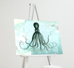 Lord Bodner's Octopus Art Print Sea Squid Vintage Nautical Decor Ocean Wall Art Giclee on Cotton Canvas and Paper Canvas. Lord Bodner's Octopus Art Print Nautical Decor Giclee print featuring the famous Lord Bodner's Octopus. We painstakingly remastered this classic ensuring every detail from the original was preserved. This statement piece brings any wall to life with a rustic, vintage beach aesthetic. Perfect print for lovers of vintage and nautical-themed illustrations. Each piece is...