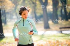 Woman jogging and listening music royalty-free stock photo