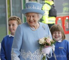 The Queen in Northern Ireland    The Queen receives flowers from local school children during a visit to South West Acute Hospital in Enniskillen, County Fermanagh, during a two-day visit to Northern Ireland as part of the Diamond Jubilee tour of the UK, 26 June 2012.  © Press Association