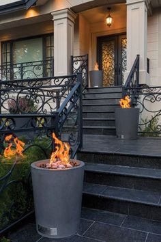 Make an entrance with the Spire fire pit. The sleek tubs in tinted concrete can line a front path or punctuate a terraced veranda. Available in propane  or natural gas. From Solus Decor. #architecture #design #fireplaces