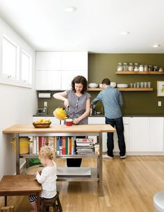 Accent and customize: To convert a musty mid-century San Francisco house with a nonsensical floor plan into a modern and space-efficient family home, three intrepid designers played a bit of architectural Tetris. In the kitchen, artist Riley McFerrin installed custom floating shelves. Photo by Daniel Hennessy.  Photo by: Daniel HennessyCourtesy of: ©2011 DANIEL HENNESSY PHOTOGRAPHY, LLC
