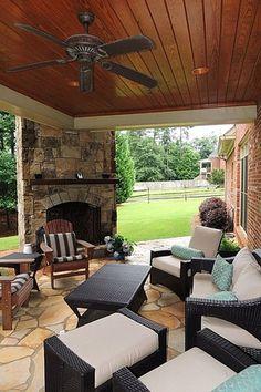 Outdoor Specialty Balcony Traditional Porch with specialty window, Wood paneled ceiling, Screened porch, Exterior stone fireplace