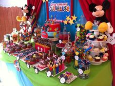 Mickey mouse club house theme bday- *Glass jars with candy! Make Mickey labels
