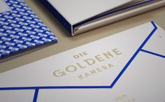 THE GOLDEN CAMERA 2014 - Invitation preview by Paperlux. Stunning - love the gold foil emboss with blue detailing on the envelope and metallic foil indicia.