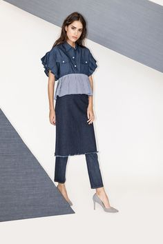 Perfect for those who love the classic fabric but hate conventional style, the quirky denim blouse is a fall essential. Here, we've paired it with, not one, but two other jean styles. Of course, you could wear this top with a pair of skinnies and call it a day, but we much prefer a truly oddball mashup.