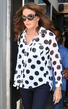 Caitlyn Jenner looked utterly fabulous in a polka-dotted blouse, accessorized with glam oversized round sunnies!