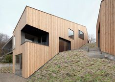 This house by architects Destilat appears to climb down a hill at the foot of the Pöstlingberg mountain in Austria.