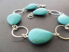 Pastel Turquoise and Silver Rings Bracelet by marygracejewellery, $22.00