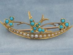 Antique Victorian 18ct gold with turquoise and seed pearls swallow pin
