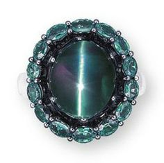 """A Cat's Eye Alexandrite and Diamond Ring~ In addition to the color change that alexandrite is known for, not many gem enthusiasts know that alexandrite can also exhibit the phenomenon of chatoyancy or the """"cat's-eye effect."""" While cat's-eye chrysoberyl is well known and highly sought after, the gem variety alexandrite itself can also exhibit a cat's-eye effect when cut en cabochon."""