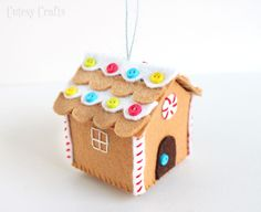 Felt Gingerbread House Ornament Tutorial - Take off the roof and little gingerbread people live inside!