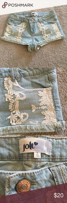 Jolt Jean Shorts with Lace Detail Light wash Jean Shorts with cute lace detail on the front pockets. Like new condition - only worn a couple of times. Great for the summer! Jolt Shorts Jean Shorts