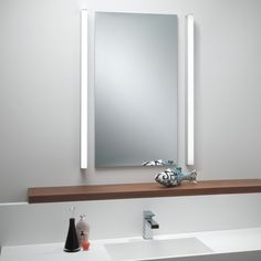 With its smooth design and stunning polished chrome finish, the Artemis 900 LED Bath Bar makes an attractive addition to modern homes and hospitality spaces. Bathroom Mirror Lights, Bathroom Shelves, Bathroom Storage, Bathroom Lighting, Mirror Lamp, Bathroom Wallpaper, Zen Bathroom, Bathroom Sets, Modern Bathroom