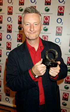 Billy Bragg poses with the Q classic songwriter award in 2007
