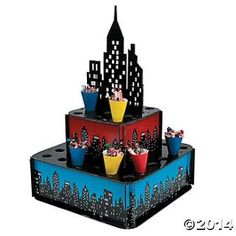 Add this cityscape black, red, and blue treat stand to your Superhero decorations for an epic table. This treat stand is easy to assemble and is to hol Superhero Treats, Superhero City, Superhero Party Supplies, Superhero Theme Party, Batman Party, Baby Superhero, Halloween Supplies, Lego Batman, Spider Man Party