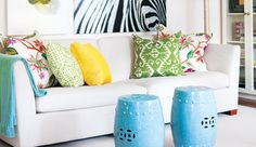 Mixing & matching toss cushions in bright colours with a neutral couch adds a pop of interest and is easy to change.