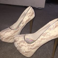 Sparkly lace high heels Very cute, very tall, sparkly laced heels. Paprika Shoes Heels