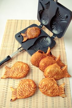 Taiyaki Pan (Japanese fish shaped cakes) | Flickr - Photo Sharing!  Use simple pancake batter and these delicious little fishies have a cream cheese, chocolate and peanut butter filling (not all together, of course)