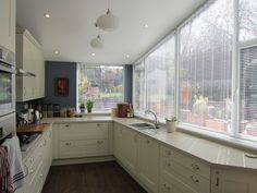Triangular Aluminium Venetian Blinds for a Shaped Sloping Window by Grand Design Blinds