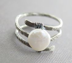 Sterling silver ring in spiral with wrapped coin by IngoDesign, $39.00