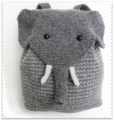 THIS makes me wish I knitted! Instructions can be found here: http://www.morehousefarm.com/KnittingKits/Bags_and_Purses/