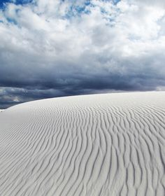 There are sugar-white dunes moving through the Chihuahuan Desert of New Mexico at a rate of nearly 30 feet per year.
