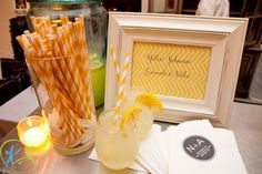 Yellow striped straws and lemonade.
