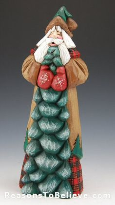 Evergreen Santa - holding a large tree, trimmed in lodge style black and red checks with accents of green trees around his robe. Designed, hand carved, detailed, painted and signed by Dave Francis. 100 percent hand crafted solid wood Santa carving.