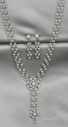 Edwardian Platinum, Seed Pearl, and Diamond Necklace, with a geometric plaque bead- and bezel-set with old European-cut diamonds, with seed pearl and fancy link chain, and suspending a conforming drop
