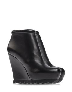 Camilla Skovgaard Saw Wedges ❤ The boots to have this season.