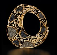 Brooch | Judith Kaufman.  18k and 22k t gold, black druze, pyrite druze.  Like the segments.