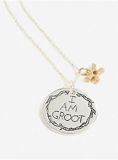 """<i>I am Groot</i>...<div><br></div><div>Channel your inner adorable talking tree with this long silver necklace featuring a coin charm that reads """"I am Groot"""" and a golden flower charm.</div><div><ul><li style=""""list-style-position: inside !important; list-style-type: disc !important;"""">Sterling silver and gold plated</li><li style=""""list-style-position: inside !important; list-style-type: disc !important;"""">32"""" chain</li><li style=""""list-style-position: inside !important; list-style-type: disc…"""
